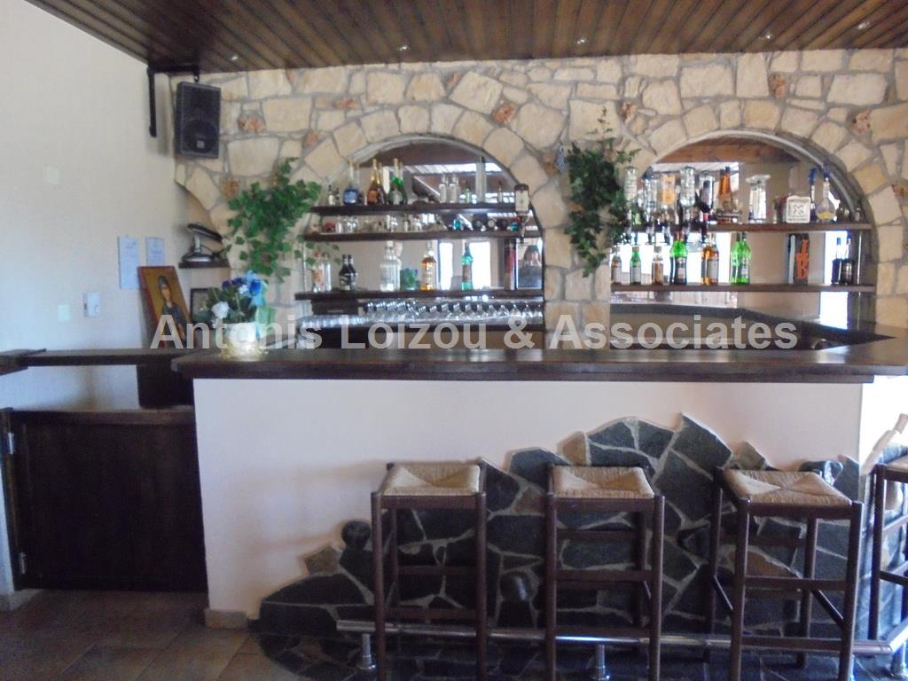 RESTAURANT WITH 3 LUXURY APARTMENTS 5 MINS AIRPORT properties for sale in cyprus